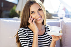 City lifestyle woman using smartphone on cafe Stock Photo