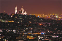 City of light. Night view of Paris - basilica Sacre-Coeur and Montmartre Stock Image