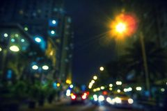 City Light Bokeh. Blurry image of buildings and night traffic in Jakarta, Indonesia Stock Photo
