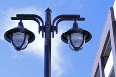 City Light Post with Two Hanging Street Lights Stock Images
