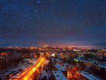City in the light of stars. The sky give your star to a small town Royalty Free Stock Photos