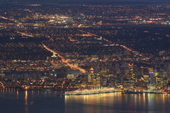City lights. Arial view of downtown city lights at night in harbour Royalty Free Stock Photography