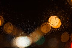 City lights abstract circular bokeh with drops royalty free stock images