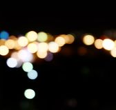 City lights in the background with blurring spots of  light Stock Images