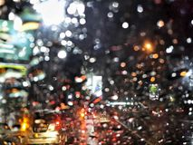 City lights bokeh. With raindops on car windshield Royalty Free Stock Images