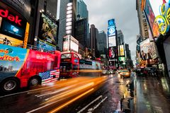 City lights of Broadway. Blured lights of busses and yellow taxes. New York. USA Stock Images