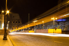 City Lights on the Colosseum. Lights of passing cars illuminate the Ancient Colosseum Stock Photos