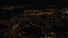 City lights from descending aircraft stock video footage