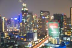 City lights in the evening. City night light blur bokeh , defocused background, Bangkok Thailand stock image