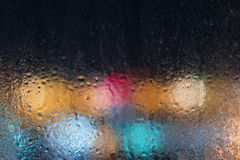 City lights through the frozen glass. Stock Image