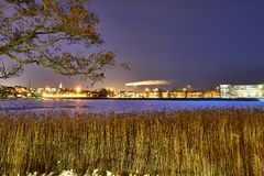 City lights and icy lake royalty free stock photo