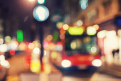 City Lights in London. The bus travels down the street in London the evening lights of headlights and street lighting. Blurry Royalty Free Stock Image