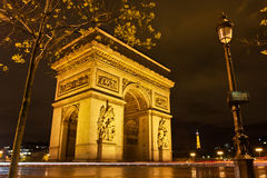 The City of Lights at Night. Paris's L'Arc de Triomphe and Eiffel Tower at night Stock Photos