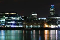 City lights at night. A colourful photo of London at night with the river Thames near London Bridge royalty free stock photo