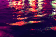 City lights reflection. Colorful glare on the water Stock Photography