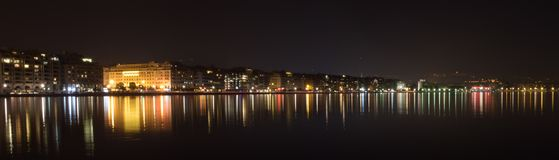 City lights reflection. A picture of a greek town thessaloniki,and the citys lights reflection in the sea,in a cold night Royalty Free Stock Images