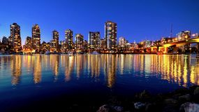 City lights reflections in a bay of water. Stock Image