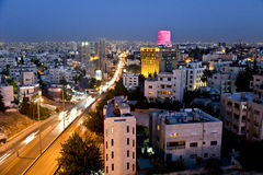 City lights after the sunset in Amman. City lights after the sunset, in the west side of Amman and Le Royal hotel within the background in Amman, Jordan Stock Photo