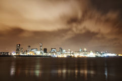 City of Liverpool, England, at night and the river Mersey royalty free stock image