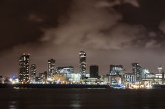 City of Liverpool, England, at night and the river Mersey royalty free stock photography