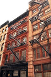 City Living. New York City historic red brick apartment buildings Royalty Free Stock Photos