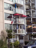 City living, Expensive apartments with balconies and red umbrellas Royalty Free Stock Photo