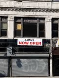 City: loan shop - closed. City loan shop with closed shutter and Open sign Royalty Free Stock Photo