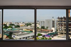 City location in the window viewer of building. City location in the glass window viewer of high tower Stock Photo