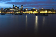City of London. Night shot over the Thames of the City of London royalty free stock photo