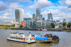 City of London and boats. Shows such iconic buildings including 20 Fenchurch street (the 'walkie talkie'), 30 St Mary Axe (the 'Gherkin') and 122 Leadenhall Stock Images