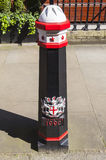 City of London Bollard. A painted and decorated Bollard in the City of London Stock Photo