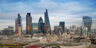 City of London, business and banking aria. London's panorama in sun set. LONDON, UK - JANUARY 27, 2015: City of London, business and banking aria. London's Stock Photography