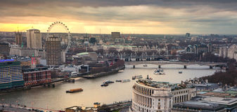 City of London, business and banking aria. London's panorama in sun set. LONDON, UK - JANUARY 27, 2015: City of London, business and banking aria. London's Royalty Free Stock Images