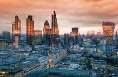 City of London, business and banking aria. London's panorama in sun set. LONDON, UK - JANUARY 27, 2015: City of London, business and banking aria. London's Stock Images