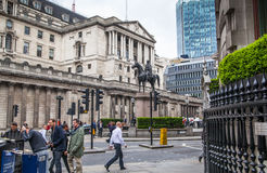 City of London business life. Group of business people walking by the Bank of England Stock Images