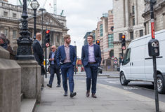 City of London business life. Group of business people walking by the Bank of England Royalty Free Stock Photos