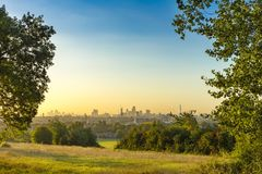 The City of London Cityscape at Sunrise with early Morning Mist from Hampstead Heath. Buildings include the Shard, Gherkin 30 St M stock photography