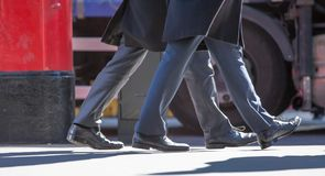 City of London, Feet of business people walking in the City of London. Busy modern life concept. Stock Photos