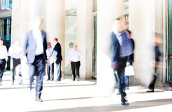 City of London lunch time. Blurred image of office people walking on the street. London, UK Royalty Free Stock Photo