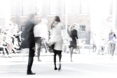 City of London lunch time. Blurred image of office people walking on the street. London, UK Stock Photos