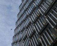 City of London, modern building, a blue sky and a plane. royalty free stock image