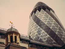 City of London. Modern and old architecture. United Kingdom. LONDON, UNITED KINGDOM - March 19, 2017: City of London. Modern and old architecture. The Gherkin Stock Image