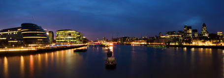City of London at night. River Thames and the City of London at twilight stock photos