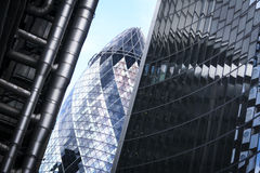 City of london office buildings gherkin uk. Perspective view of street in the city of london financial district with striking modern architecture of the swiss re Royalty Free Stock Photography