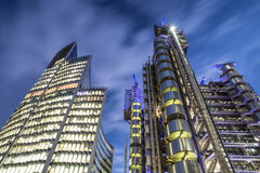 City of London office business buildings with lights on at night. Stunning view of the finance district in London stock image