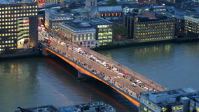 City of London, River Thames and London Bridge at night. LONDON, UK - JANUARY 27, 2015: City of London, River Thames and London Bridge wit blots of cars and stock video