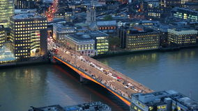 City of London, River Thames and London Bridge at night. LONDON, UK - JANUARY 27, 2015: City of London, River Thames and London Bridge wit blots of cars and stock video footage