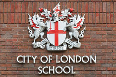 City of London school sign on red bricks wall, London. City of London school sign on red bricks wall on August 5, 2015 in London, UK. The also known as CLS is an Royalty Free Stock Photos