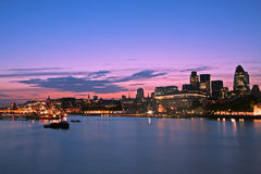City of London, skyline. Skyline of the City of London at dusk. Thames River on foreground, copy space in the sky Stock Photo