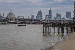 City of London skyline, as viewed from the south bank of the river Thames. St. Paul`s can be clearly seen along side the modern day sky scrapers Royalty Free Stock Photo